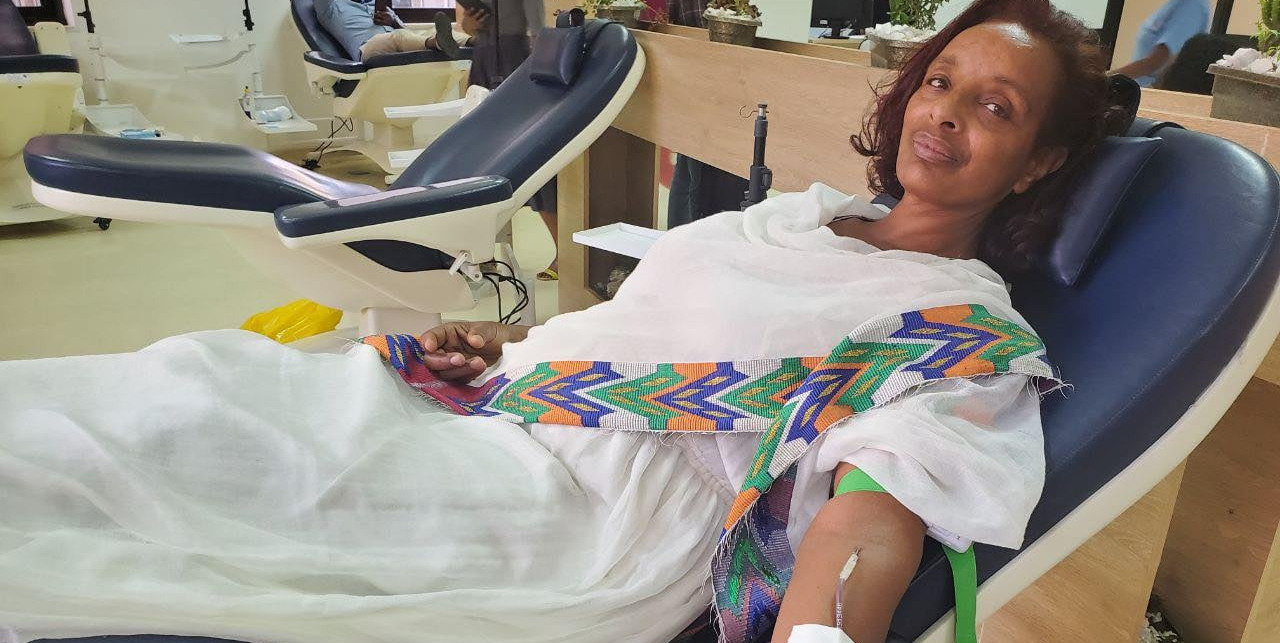 May be an image of text that says 'Lia Tadesse, Minister of Health 26m ሲ/ር አሠጋሽ ጎሳ ነርስም፣ እናትም ቀዳሚ ደም ለጋሽም በመሆን ዛሬ የሴቶች ቀንን በማስመልከት 80ኛ የደም ልገዛዋን አድርጋለች። ይህ ቁጥር በሃገራችን ሴት ደም ለጋሾች በሪከርድ የተመዘገበ ነው። እንኳን ደስ አለሽ! እናመሰግናለን! Sr. Asegash Gosa has donated blood for the 80th Blood Donation today, which is the highest recorded number in our country' female blood donors. Sr. Asegash is a nurse, a mother and a proud blood donor. Congratulations! Thank you!'